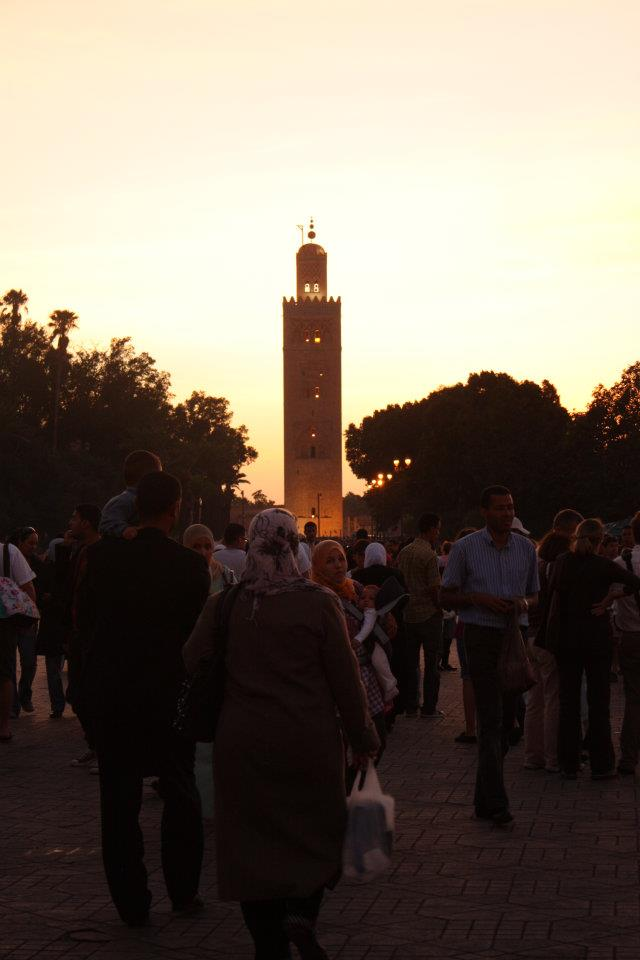The minaret of the mosque stands proudly as the sun sets.